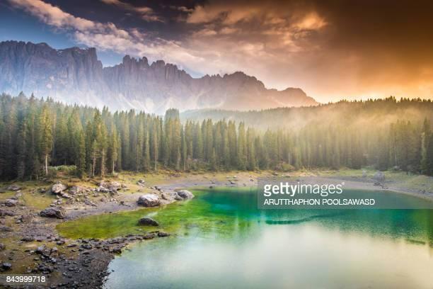 Carezza lake sunrise on the reflection lake , dolomite Italy , South tyrol