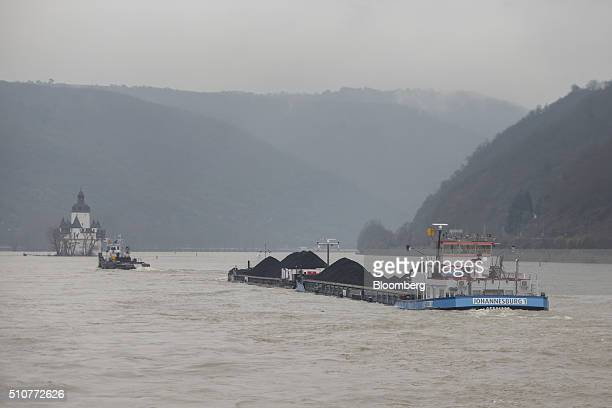 A cargo barge transports coal as it sails on the River Rhine in Kaub Germany on Saturday Feb 13 2016 The cost of shipping heating oil and gasoline by...