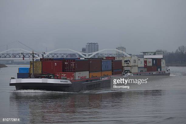 A cargo barge transports shipping containers on the River Rhine in Ludwigshafen Germany on Saturday Feb 13 2016 The cost of shipping heating oil and...