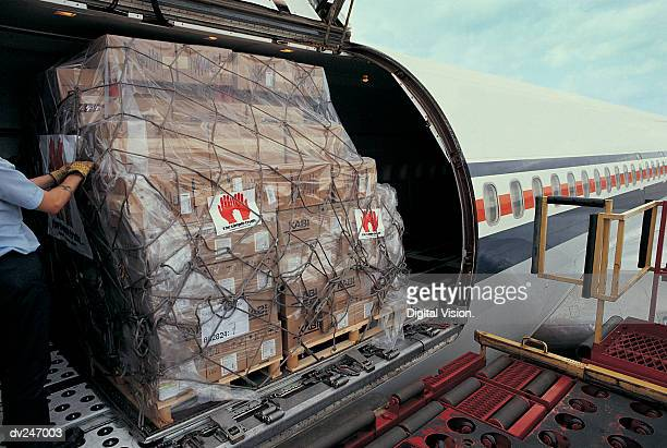 Cargo being loaded onto airplane