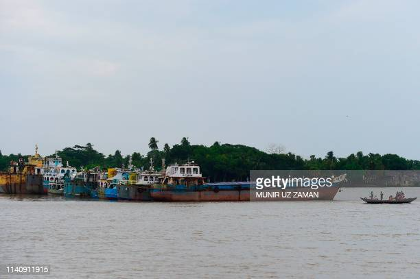 Cargo boats are seen moored in the Rupsha river in Khulna on May 3 as Cyclone Fani barrels northeastwards into West Bengal state and towards...