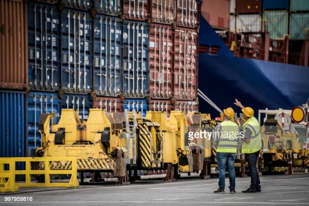 cargo container exam - dock worker stock photos and pictures