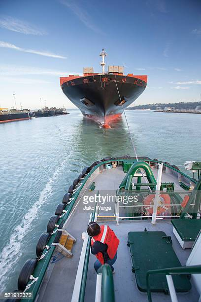 cargo container ship bow, viewed from tugboat - jake warga stock pictures, royalty-free photos & images