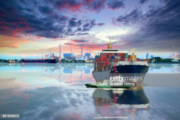 cargo container ship - tugboat stock photos and pictures
