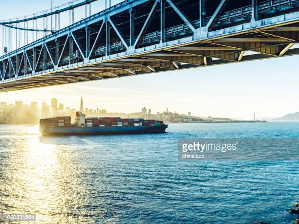 cargo container ship sailing on pacific ocean - pacific ocean stock pictures, royalty-free photos & images