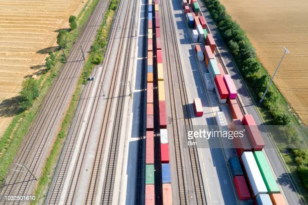 cargo containers and freight trains, aerial view - rail transportation stock pictures, royalty-free photos & images