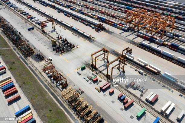 cargo containers and freight trains, aerial view - rail freight stock pictures, royalty-free photos & images