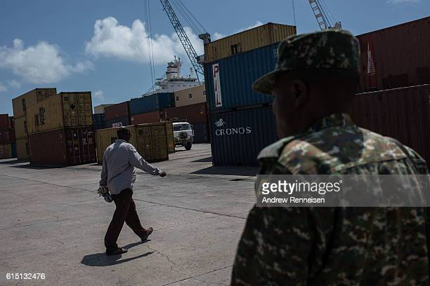 Cargo containers are unloaded at the Port of Mogadishu on October 13 2016 in Mogadishu Somalia Somalia is on the brink of its first parliamentary...