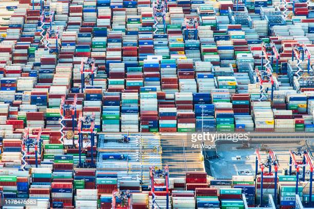 cargo containers at a los angeles seaport. - port of los angeles stock pictures, royalty-free photos & images
