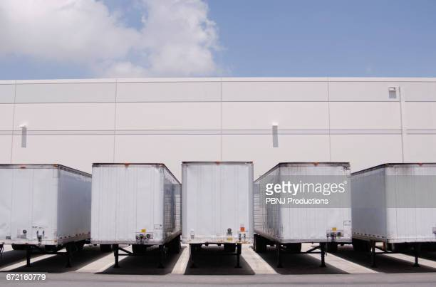Cargo containers at loading docks