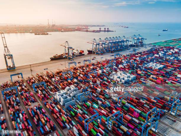 cargo containers at qingdao port in china, asia - qingdao stock pictures, royalty-free photos & images