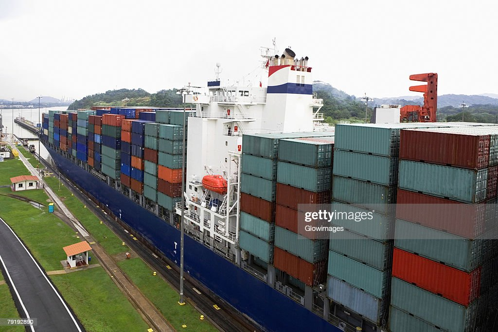 Cargo containers in a container ship at a commercial dock, Panama Canal, Panama : Foto de stock