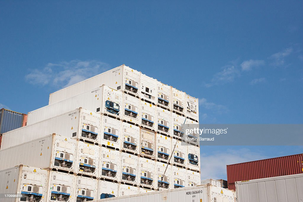 Cargo containers in dockyard : Stock Photo