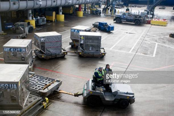 Cargo containers loaded onto aircraft OêHare Field airport Chicago Illinois USA.