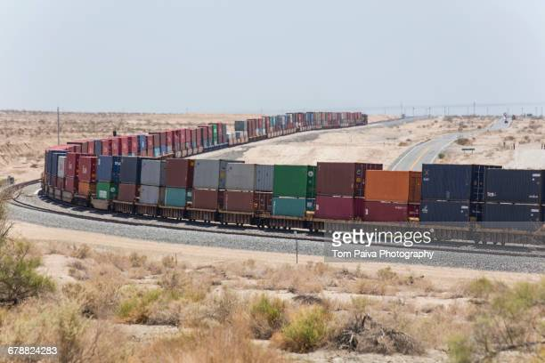 Cargo containers on curving railroad track