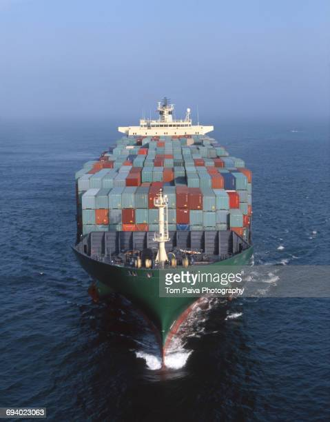 Cargo containers on freighter in ocean