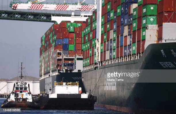 Cargo containers sit stacked on container ships at the Port of Los Angeles, the nation's busiest container port, on October 15, 2021 in San Pedro,...