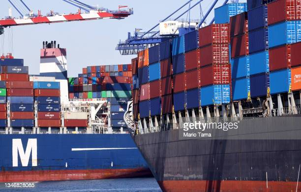 Cargo containers sit stacked on ships at the Port of Los Angeles, the nation's busiest container port, on October 15, 2021 in San Pedro, California....