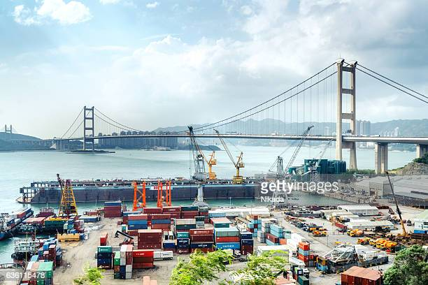 Cargo freight ship with working crane in shipyard Singapore