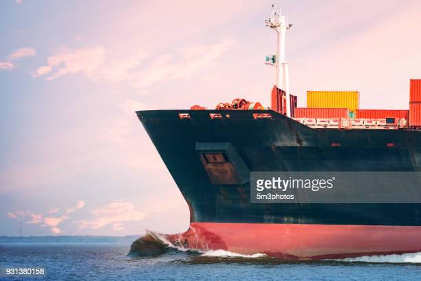 cargo freighter ship with intermodal shipping containers at sea - tariff stock pictures, royalty-free photos & images