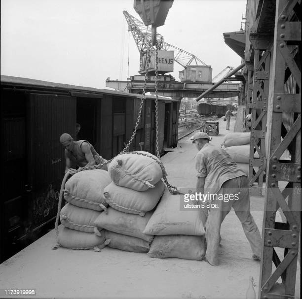 Cargo handling unloading sacks Rhine port Basle 1954