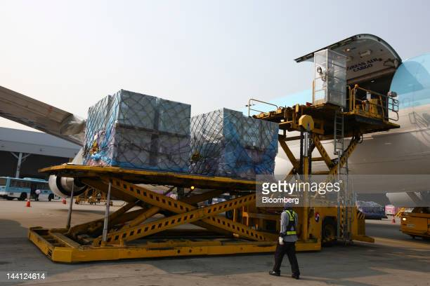 Cargo is unloaded from a Korean Air Lines Co freight plane arriving from China at the company's cargo terminal at Incheon International Airport in...