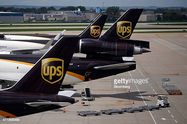 Cargo jets sit parked on the tarmac while being unloaded during the afternoon sort at the United Parcel Service Inc Worldport facility in Louisville...