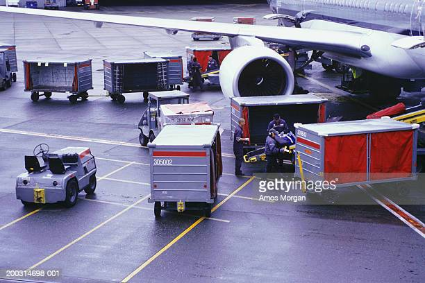 Cargo plane and containers on runway, elevated view