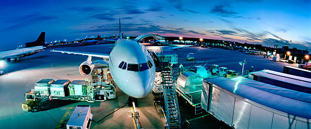 Cargo plane being loaded at night, elevated view