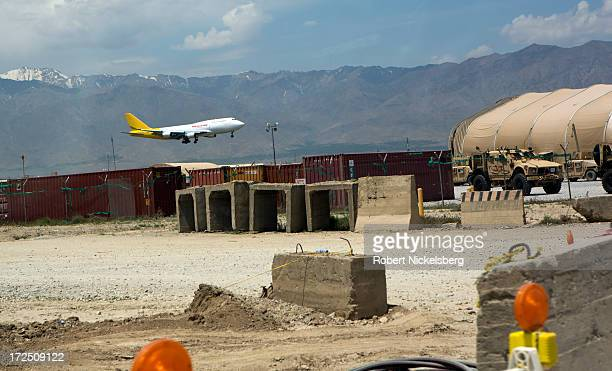 Cargo plane lands May 10, 2013 at Bagram Air Base, Afghanistan. The process is part of the military withdrawal of NATO and American troops, to be...