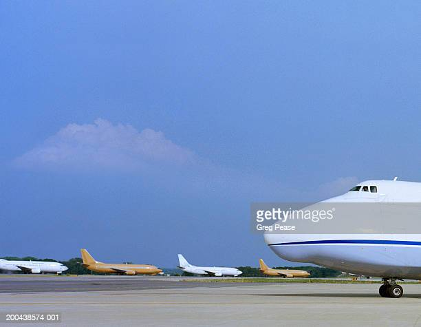 Cargo plane on tarmac, side view, close-up