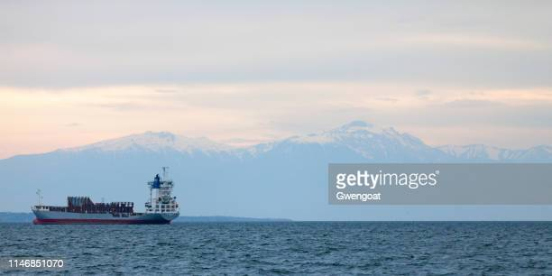 Cargo ship anchored in the Thermaic Gulf in front of the  Olympus Mount at sunset