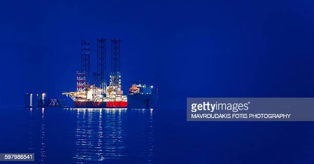 cargo ship at dusk - hydrocarbon stock pictures, royalty-free photos & images