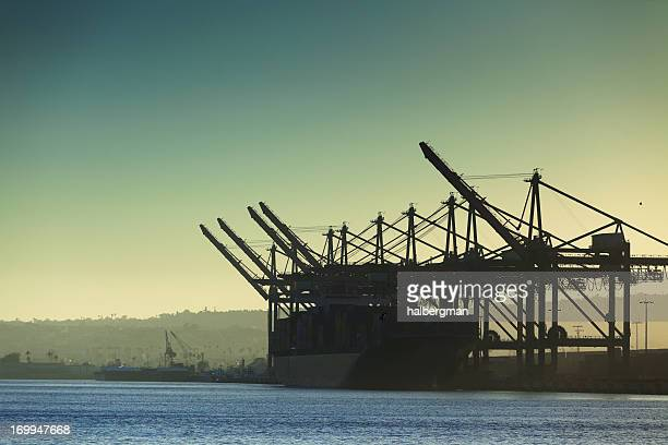 cargo ship being loaded at port of la - port of los angeles stock pictures, royalty-free photos & images
