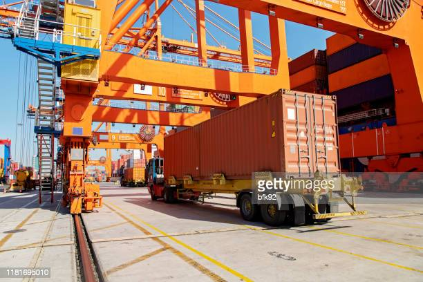 cargo ship being loaded with containers at port. - loading dock stock pictures, royalty-free photos & images