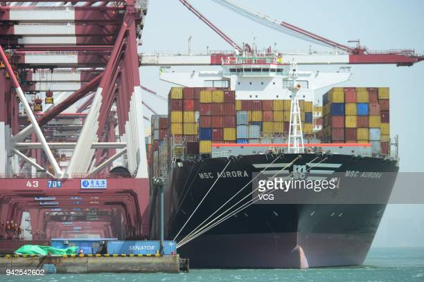 A cargo ship carrying containers stops at Qingdao Port on April 6 2018 in Qingdao China China will fight back at any cost Chinese authorities said...
