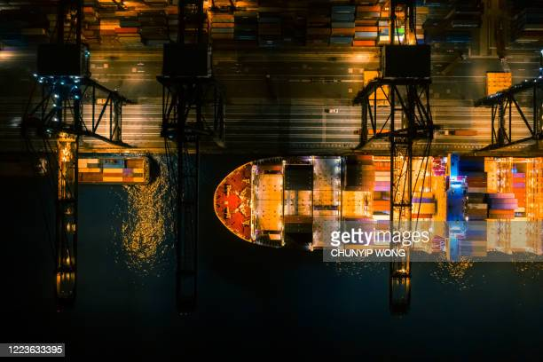 cargo ship containers shipment seaport top view drone aerial view at night - trade war stock pictures, royalty-free photos & images