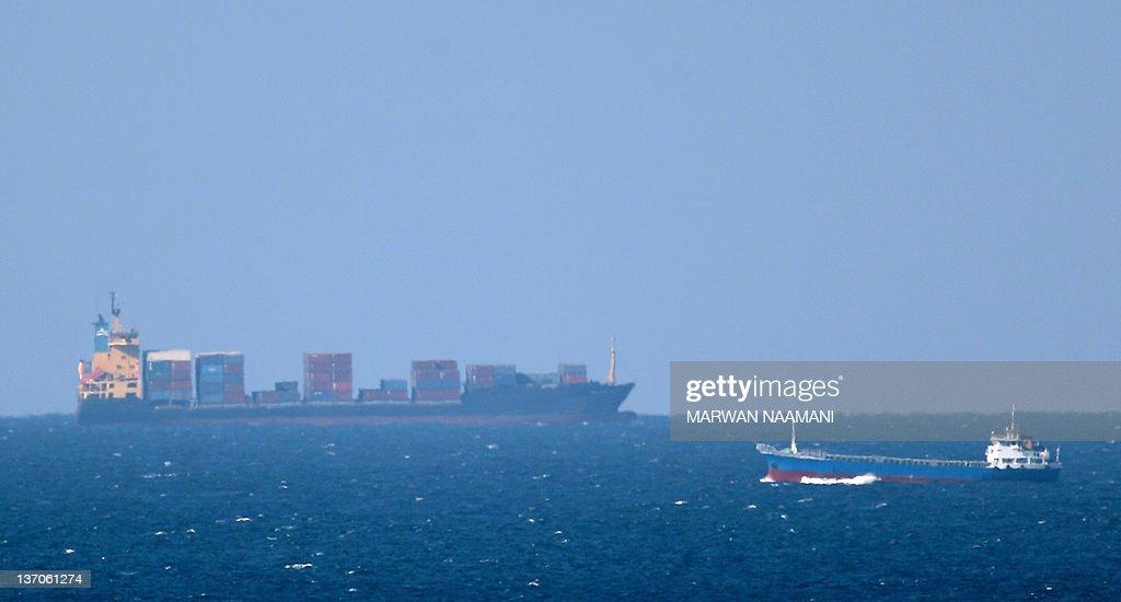 A cargo ship cruises towards the Strait : News Photo
