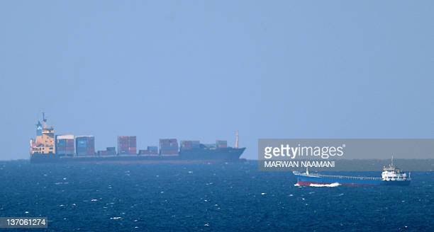 A cargo ship cruises towards the Strait of Hormuz off the shores of Khasab in Oman on January 15 2011 Iran threatened to close the Strait of Hormuz...