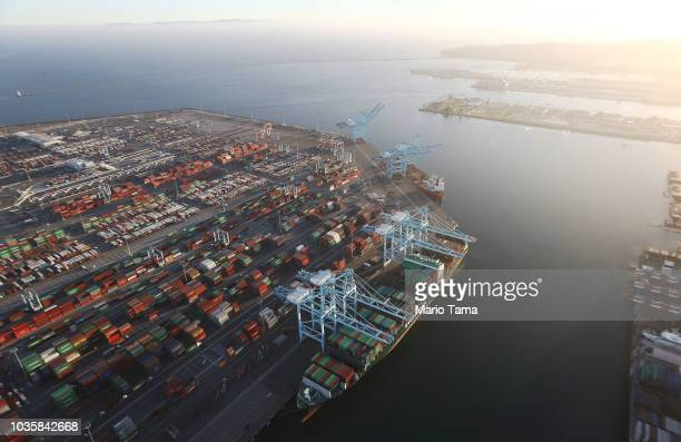 A cargo ship holds shipping containers as other containers sit at the Port of Los Angeles the nation's busiest container port on September 18 2018 in...