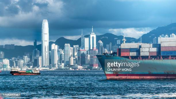 cargo ship in hong kong - trade war stock pictures, royalty-free photos & images