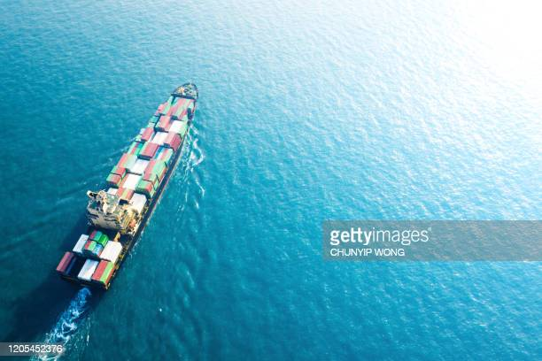 cargo ship in hong kong - trade war stock pictures, royalty-free photos & images