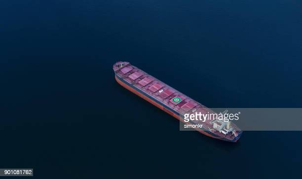 cargo ship in sea - barge stock photos and pictures
