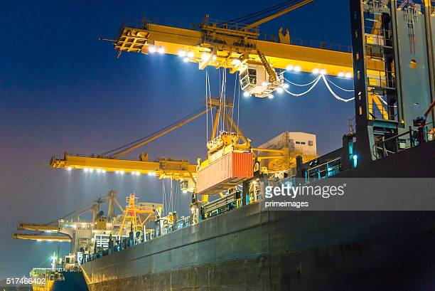 cargo ship in the harbor at night - cargo ship stock pictures, royalty-free photos & images