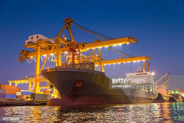 Cargo ship in the harbor at night