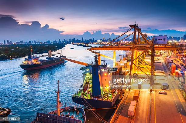 cargo ship in the harbor at sunset . - harbour stock pictures, royalty-free photos & images