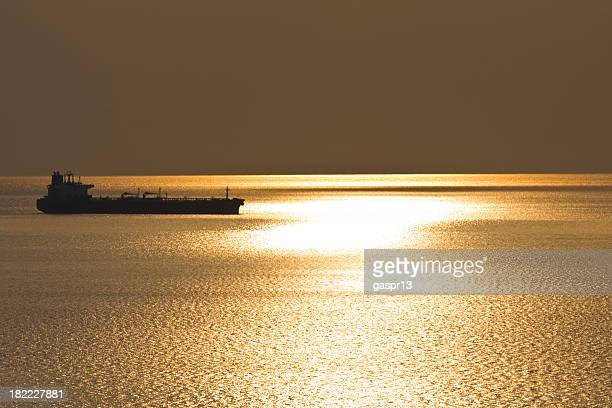 cargo ship in the sunset