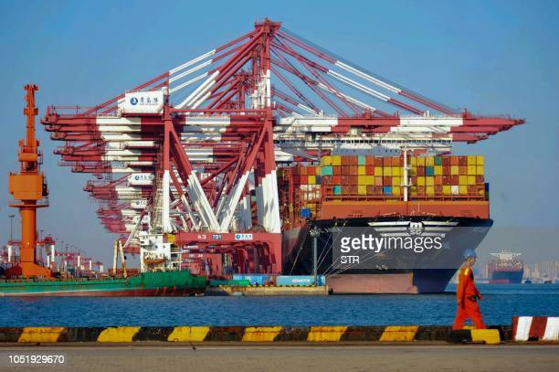 A cargo ship is seen at a port in Qingdao in China's eastern Shandong province on October 12 2018 China's trade surplus with the United States...