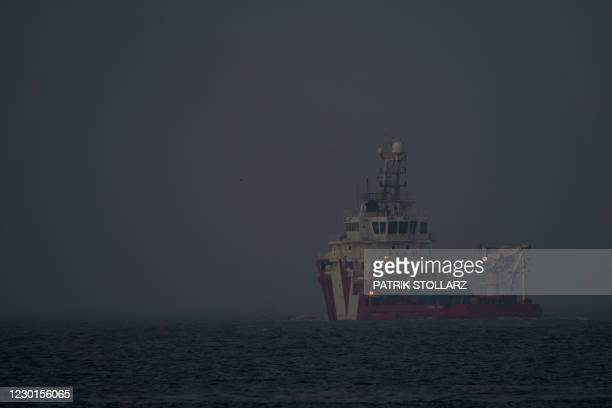 Cargo ship leaves the harbor CuxPort at the North Sea in Cuxhaven, northern Germany, on December 16, 2020. - As most of the trade handled here is...