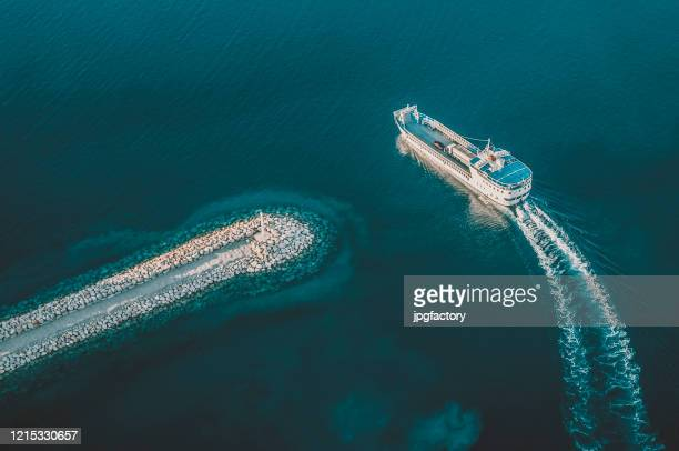 cargo ship leaving the harbor - ferry stock pictures, royalty-free photos & images